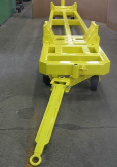 Custom cradle trailers handle enormous paper machine rollers